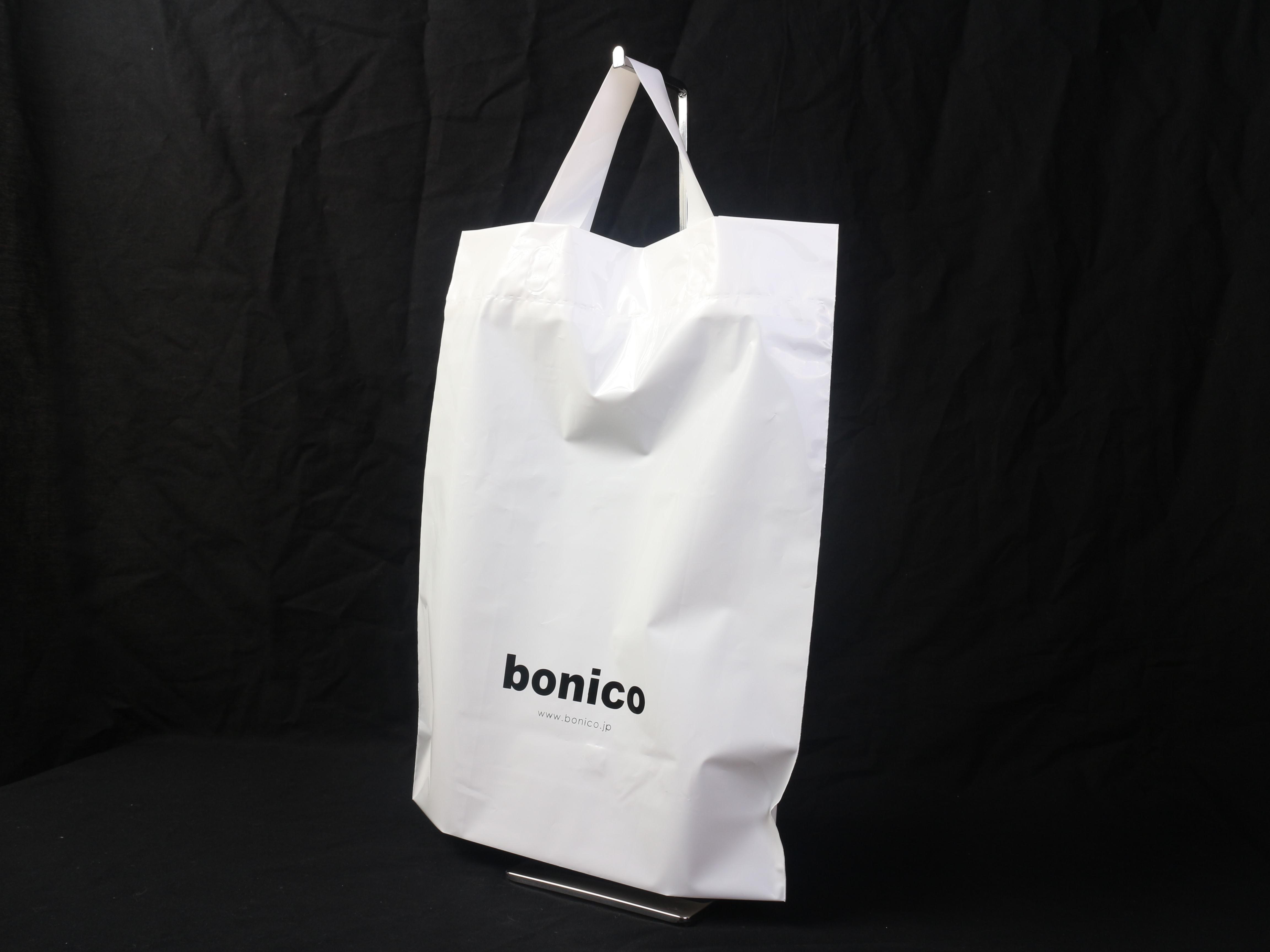 シューズやバッグなど旬なファッションアイテムを取り扱われている店舗様のショップバッグ